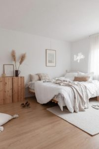 come disporre tappeti in camera da letto